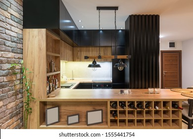 Kitchen and dining area in open plan apartment interior