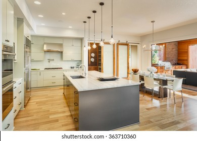 Kitchen, Dining Room, and Outdoor Patio in New Luxury Home. Slid
