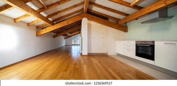Kitchen in empty apartment with wooden beams. Nobody inside