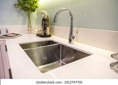 Kitchen faucet and sink close up