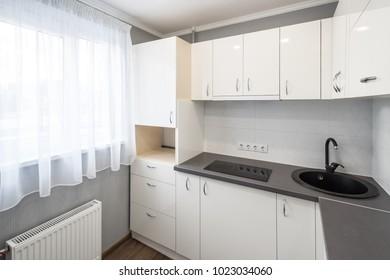 Kitchen in flat. White furniture.