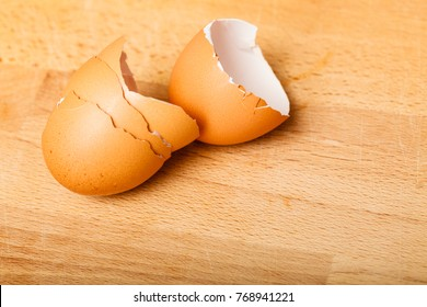 Kitchen food products details concept. Detailed closeup of empty cracked eggshells left after cooking.