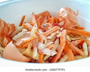 Kitchen food waste, biological. vegetable peels, apples skin, onion, carrots gathered for composting. Green Living, Zero waste, Environmental Awareness Concept. - Close up