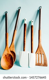 Kitchen foody background, utensil, wooden spatula, on a blue background,kitchen commerce conceptual, blog of food.