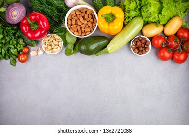 Kitchen - fresh colorful organic vegetables captured from above top view, flat lay. Grey stone worktop as background. Layout with free text.