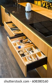 Kitchen furniture with open drawers