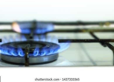 Kitchen gas stove with burning gas flame close up.