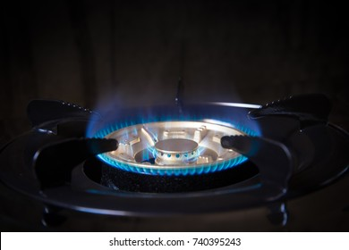 Kitchen Gas Stove with LPG energy flame closeup head fire working clean new