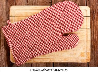 kitchen glove on cutting board
