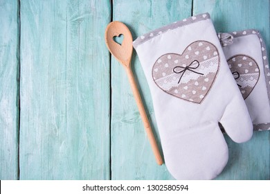 kitchen glove on turquoise surface