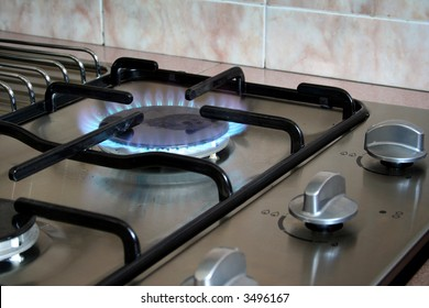 A kitchen hob with the gas turned on.