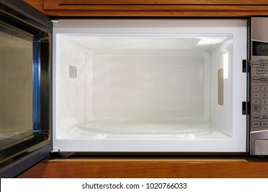 Kitchen home appliances interior inside view of empty microwave