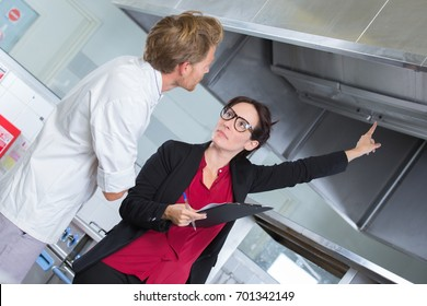 kitchen inspector pointing to extractors