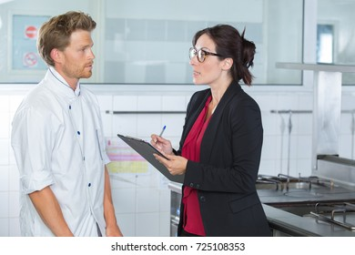 kitchen inspector questionning chef