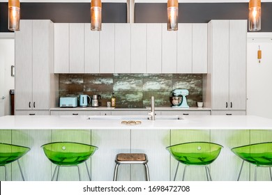 Kitchen interior with colourful decor and tiled splash back and pendant lighting. Modern kitchen interior close up. Photographed: February, 2020.