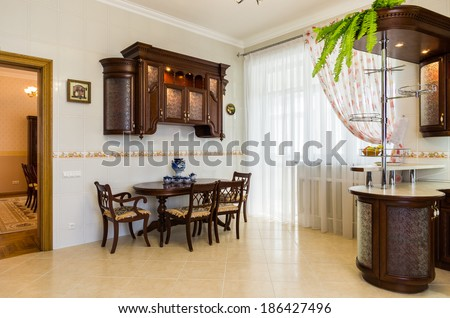 Kitchen Interior With Dining Table And Breakfast Bar
