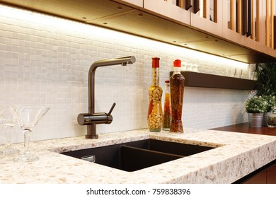 Kitchen interior, glass bottles with corn, nuts, oil, jam in a modern kitchen with a luxury mixer, breakfast concept, kitchen background, concept of healthy eating, interior of modern kitchen