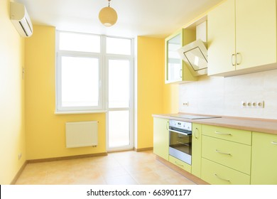 Kitchen interior in modern apartment. Light yellow empty sunny room