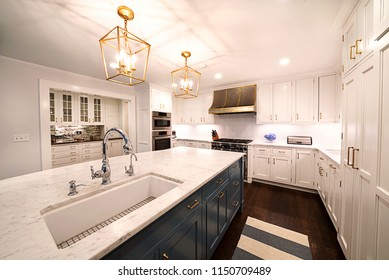 Kitchen Interior with in New Luxury Home. Features Elegant Pendant Light Fixtures
