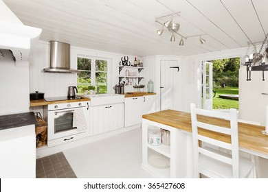 kitchen interior with open door out to the garden