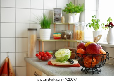 Kitchen interior with small shelf with pot-herb and kitchen implements