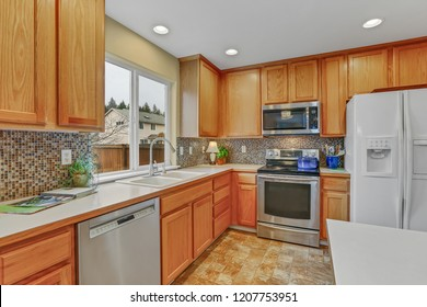 Kitchen interior with tone natural wood.