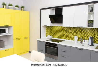 Kitchen interior in yellow colors , illuminating and Ultimate Gray.