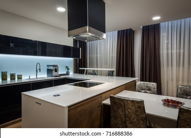 Kitchen island and chimney in modern kitchen interior