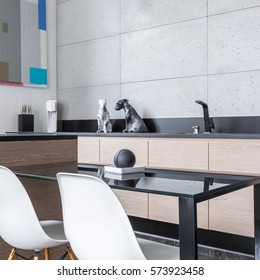 Kitchen with island, table chairs, long worktop and grey tiles