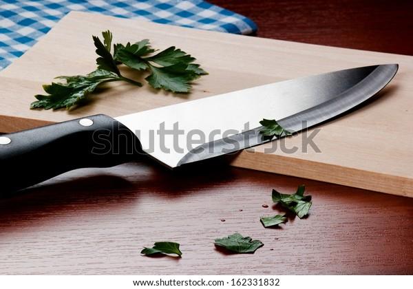 Kitchen Knife on cutting board