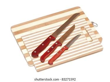 Kitchen knifes on board on white