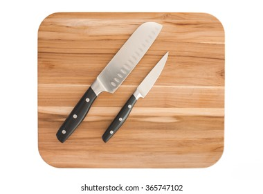 Kitchen knives on cutting board. Isolated on white.