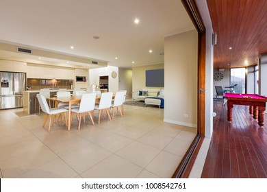 Kitchen, living room and outdoor entertainment area in luxury home