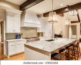 Kitchen in Luxury Home with Island, Sink, Cabinets, and Hardwood Floors