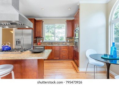 Kitchen in luxury home with stainless steel appliances and breakfast nook.