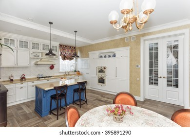 Kitchen in the magnificent house with a blue table the island