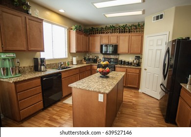 Kitchen with Medium Wood Cabinets and Granite Coutertops