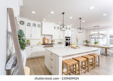A kitchen in a modern farmhouse.