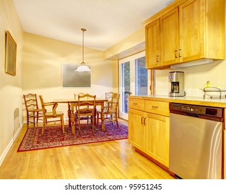 Kitchen in orange warm colors and dining room.