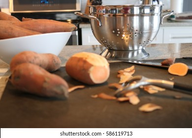 In the kitchen prepping organic sweet potatoes for a delicious healthy meal.