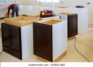 Kitchen Remodel Beautiful kitchen man assembling kitchen furniture