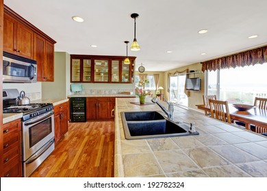 Kitchen room with dining area. View of kitchen island with built-in sink.