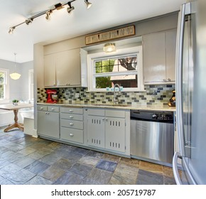 Kitchen room interior with bright dining area. View of tile back splash trim