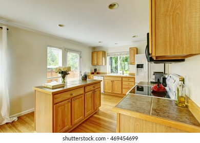 Kitchen room interior with wooden cabinets with marble tile counter top. Northwest, USA