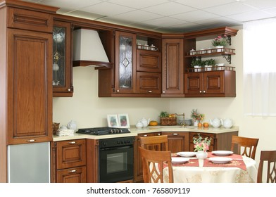 kitchen room interior and wooden table with chair on backdrop. brown wooden table with dishes and background with space image. Empty copy space for objects of food