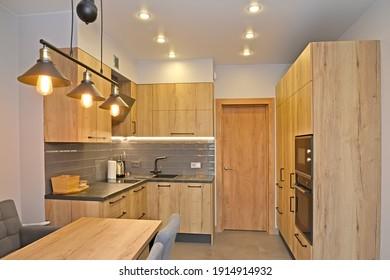 Kitchen room with lighting. Modern minimalism with loft elements