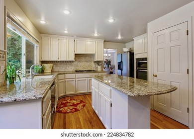 Kitchen room with white storage combination, granite tops and kitchen island