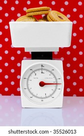 kitchen scales with cookies, diet concept