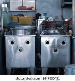 Kitchen set up at a Chinese hawker stall in Singapore or Penang Asia