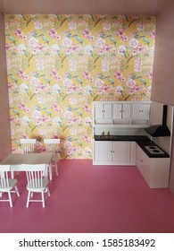 a kitchen setting in a dollhouse